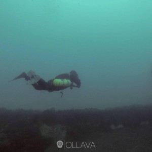 Streamlined sidemount diver at a wreck in Cape Town